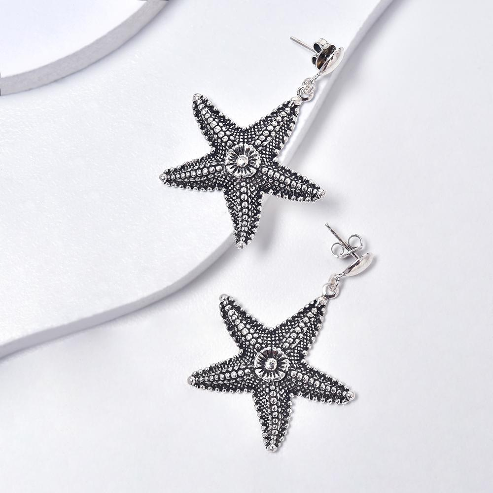 Starfish Earrings in Aged White Gold Plated