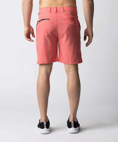 Salmon, hybrid chino shorts designed for leisure and active wear.  Constructed with 4-way stretch material and soft mesh pocket bags that allow for greater mobility.