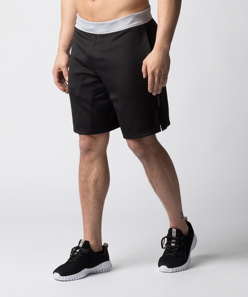 Black, heavy-weighted shorts constructed for CrossFit training.  A shorter inseam and side-slit removes snagging at the knees in Olympic movements.