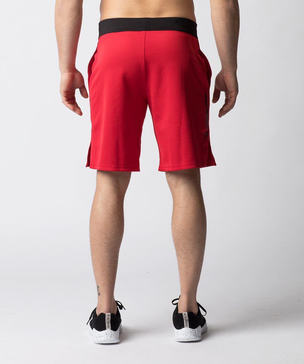 Red, heavy-weighted shorts ideal for metabolic conditioning in cooler temperatures.  With a shorter inseam and an enhanced side-slit to remove snagging at the knees, the short is constructed for Cross Training and Functional Fitness Movements.