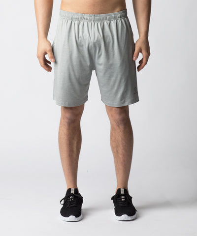 Light Grey, lightweight training short with side pockets and a wider leg opening for enhanced mobility.  A shorter inseam adds versatility allowing for quick, powerful movements such as squats.