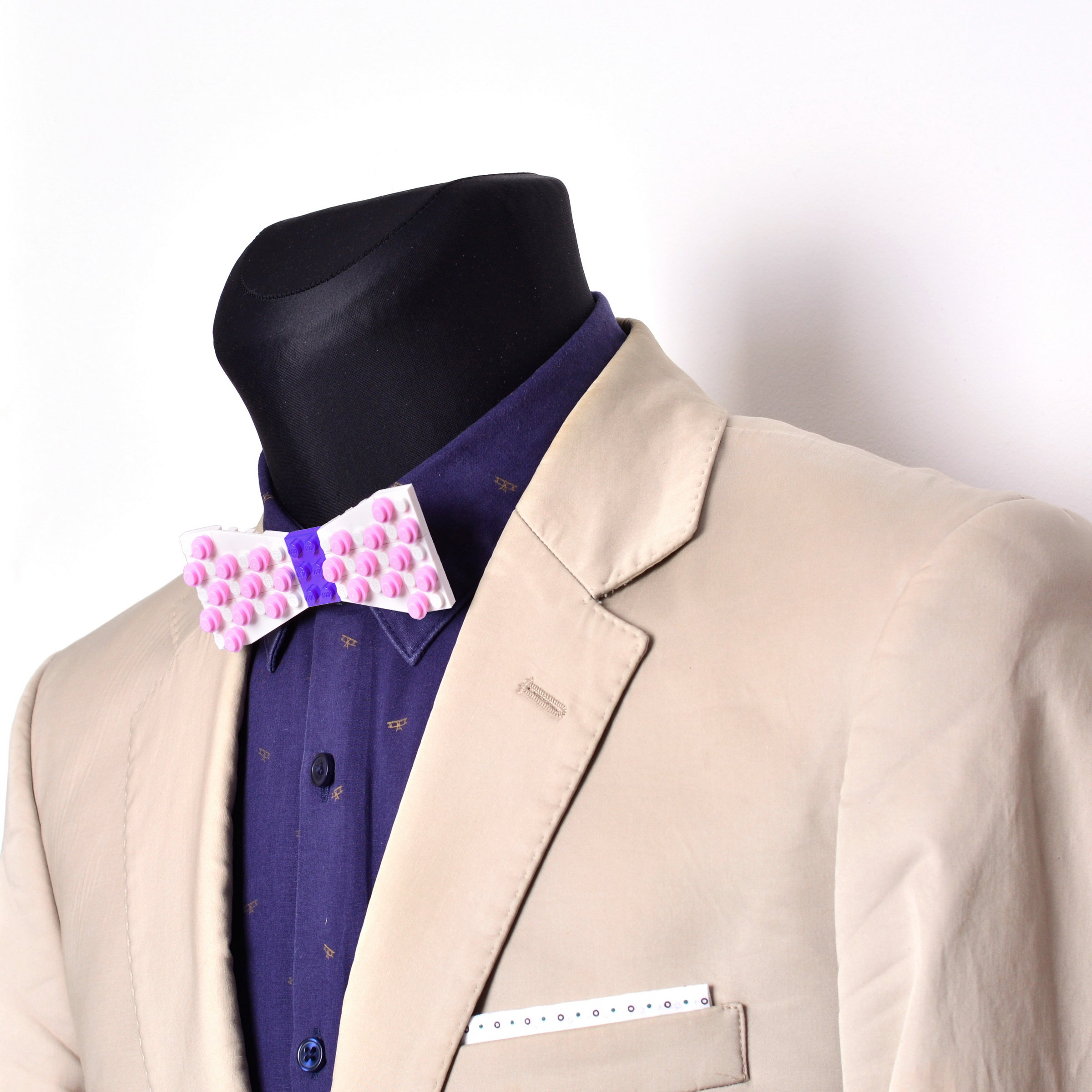 White with purple center and pink dots