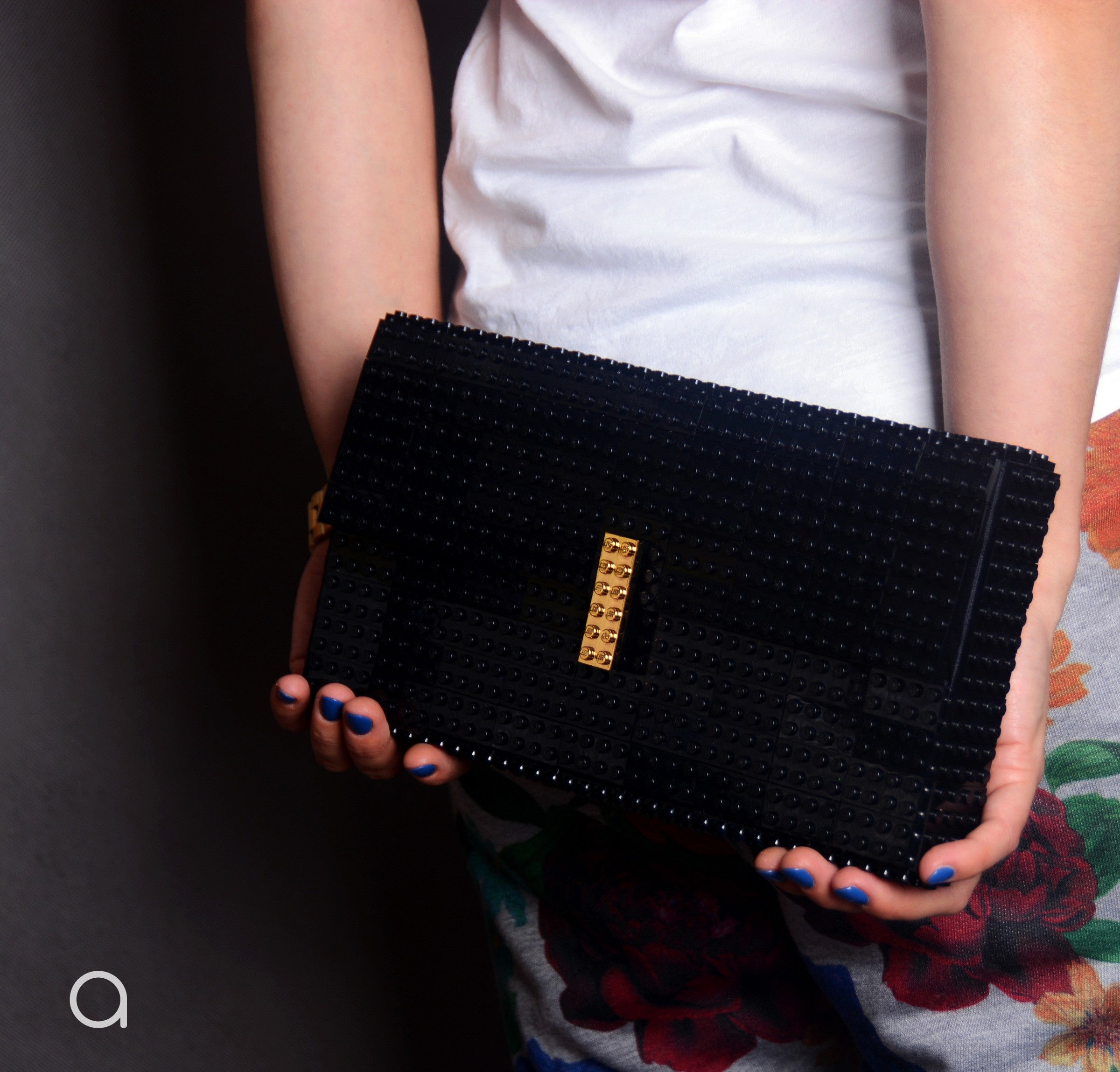 Black oversize bulk clutch with goldplated lock