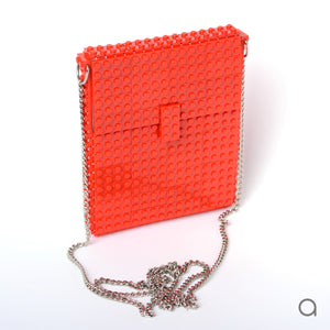 Red hip clutch on a chain