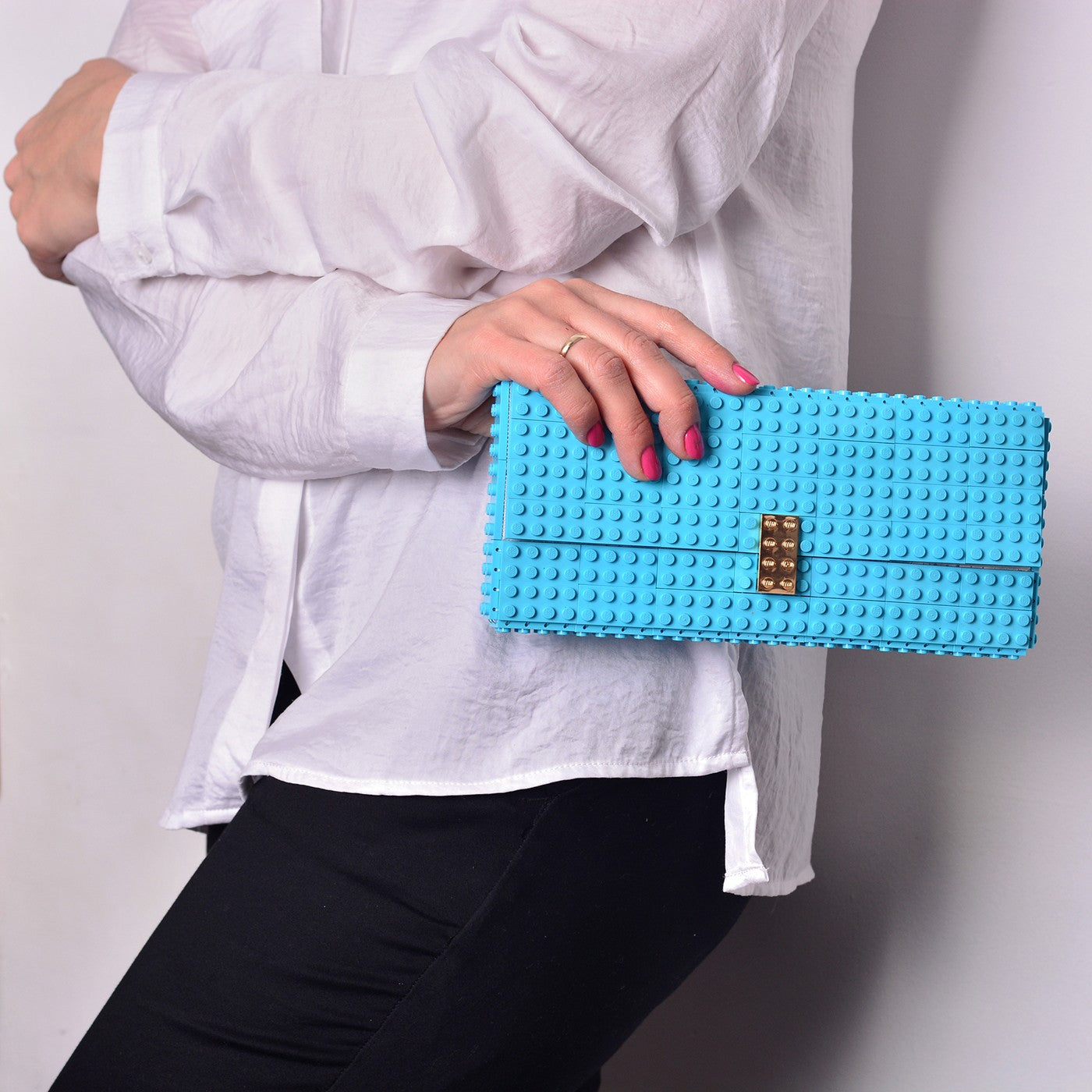 Azure clutch with goldplated lock