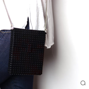Black hip clutch on a chain