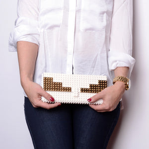 White clutch with goldplated wings