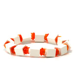 white & transparent orange beaded bracelet