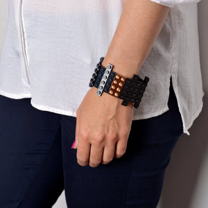 Black flat bracelet with goldplated brick