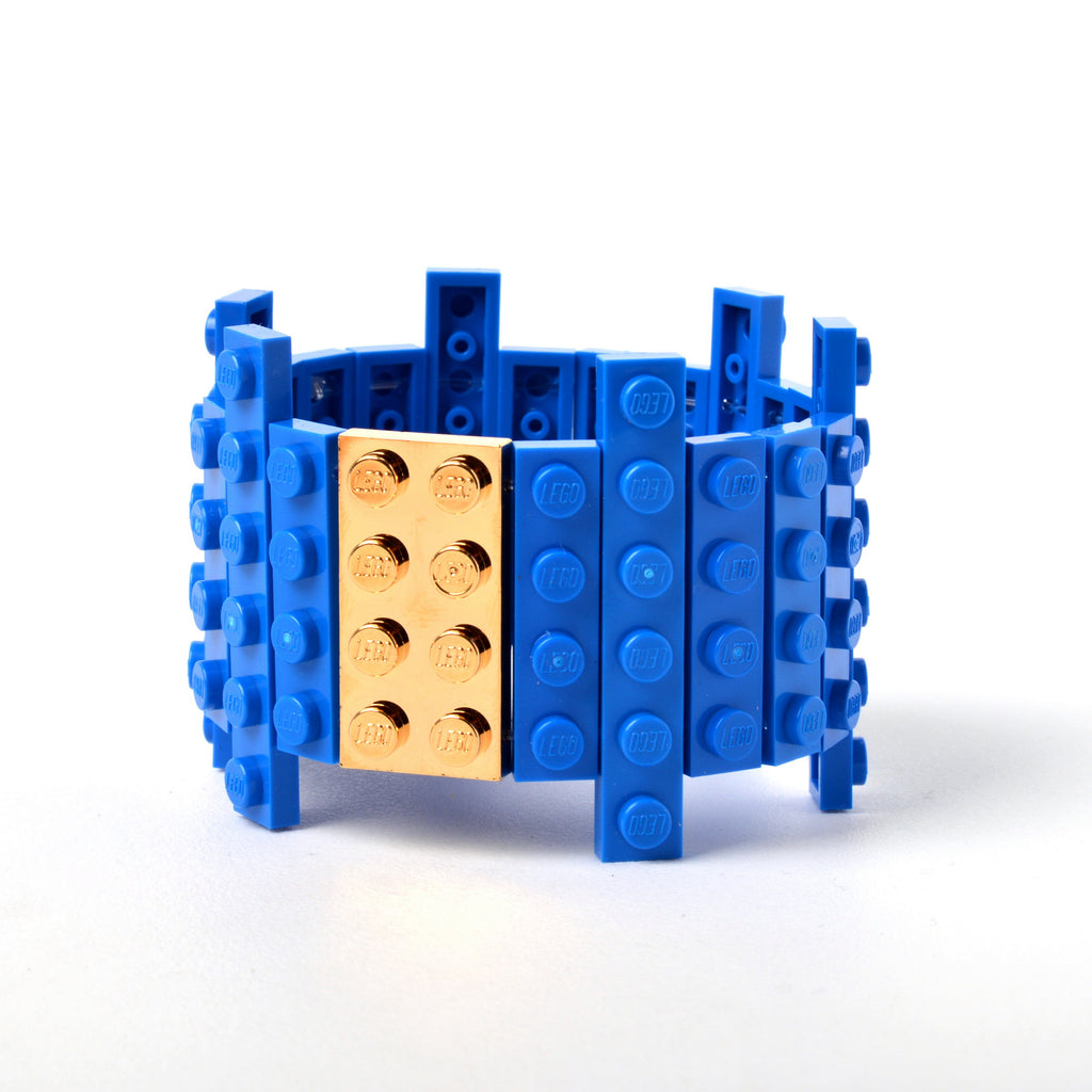 Blue flat bracelet with goldplated brick