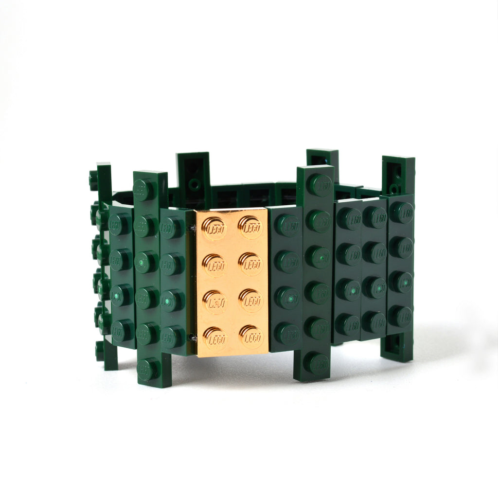 Dark green flat bracelet with goldplated brick