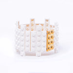 White flat bracelet with goldplated brick