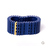 Dark blue striped bracelet with goldplated brick