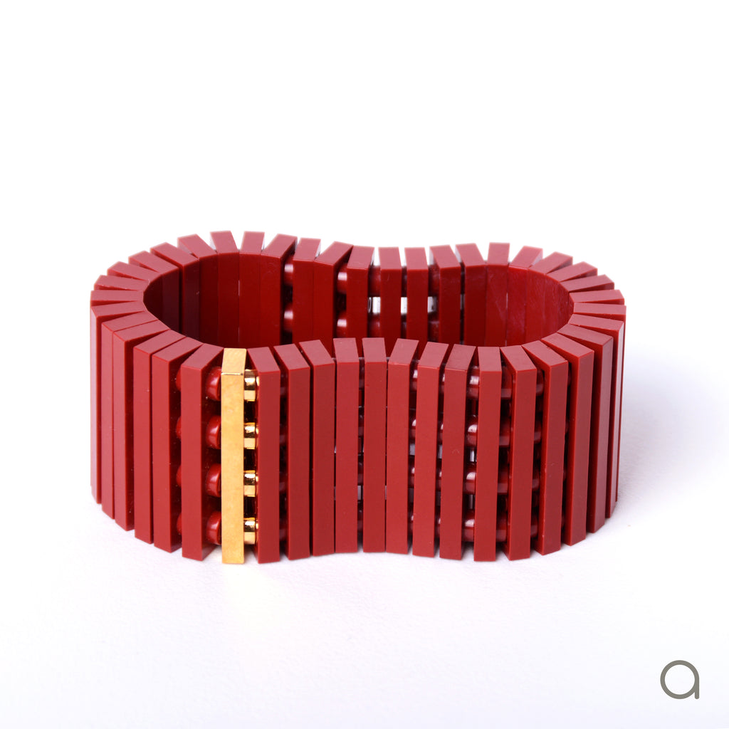 Dark red striped bracelet with goldplated brick