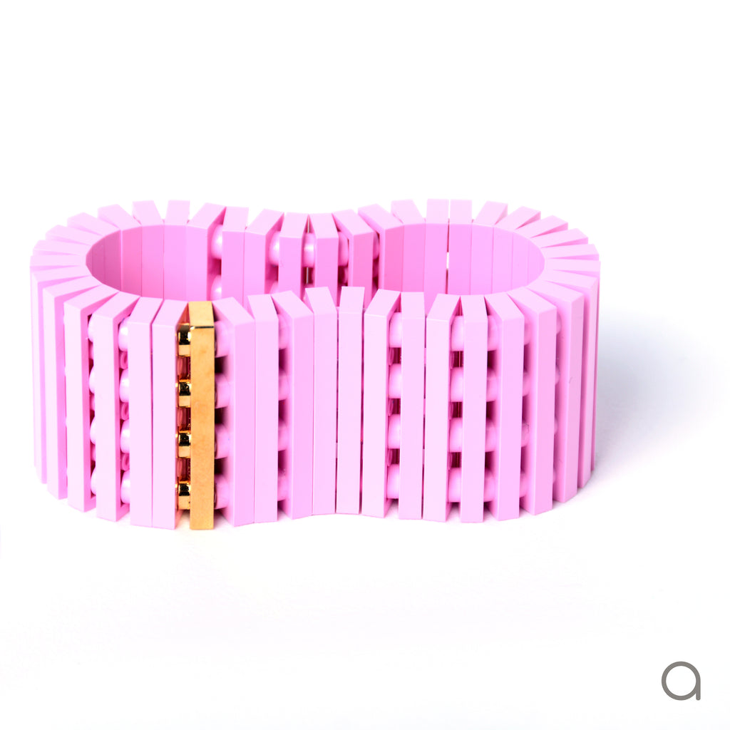Light pink striped bracelet with goldplated brick