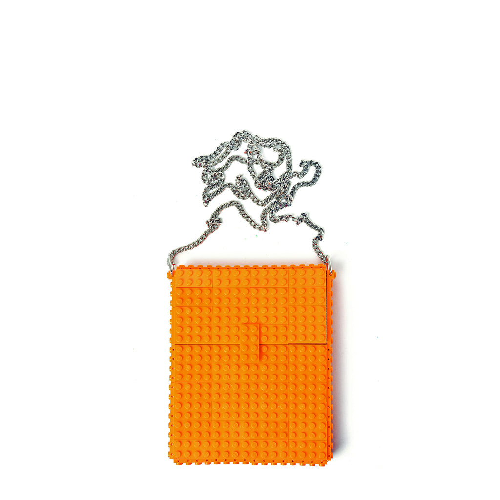 Orange hip clutch on a chain