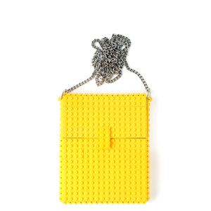 Yellow hip clutch on a chain