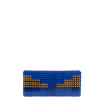 Dark blue clutch with goldplated wings