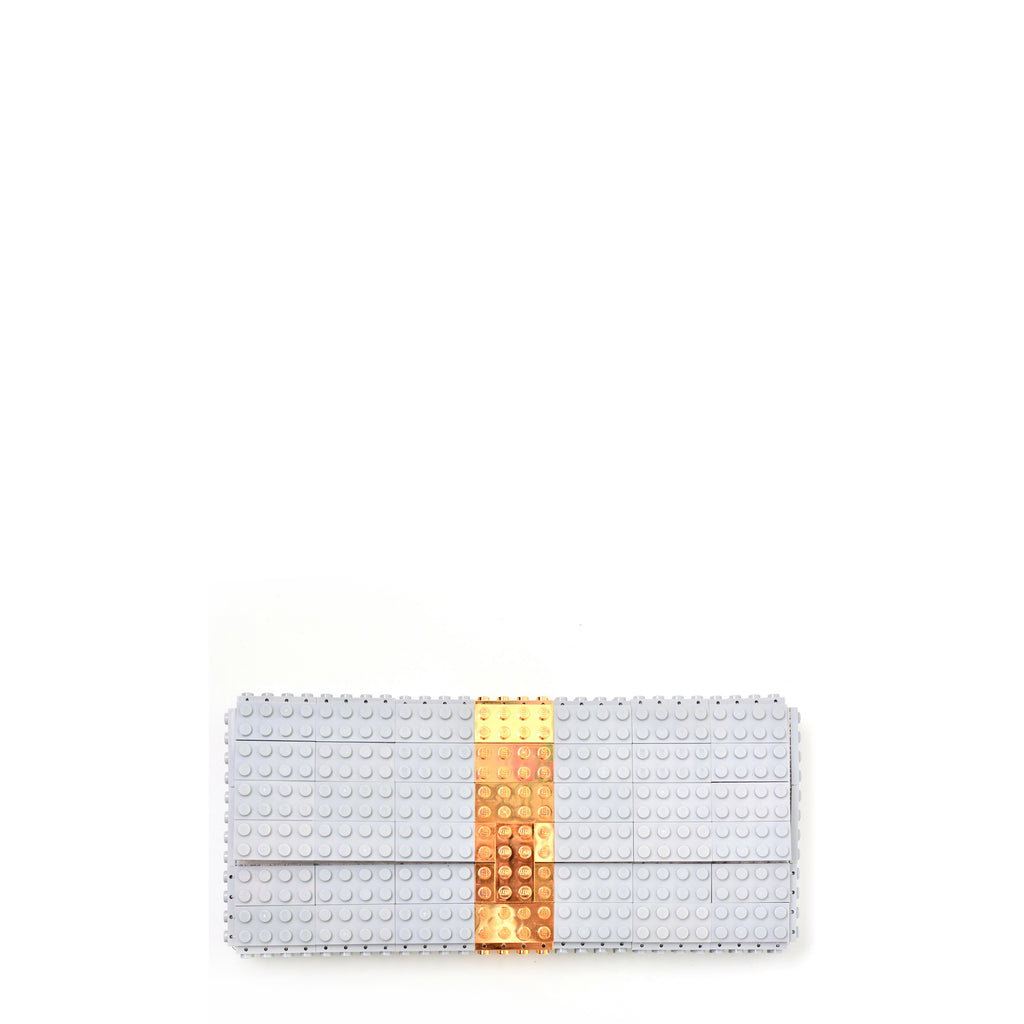3a69267434 Light grey clutch with goldplated stripe
