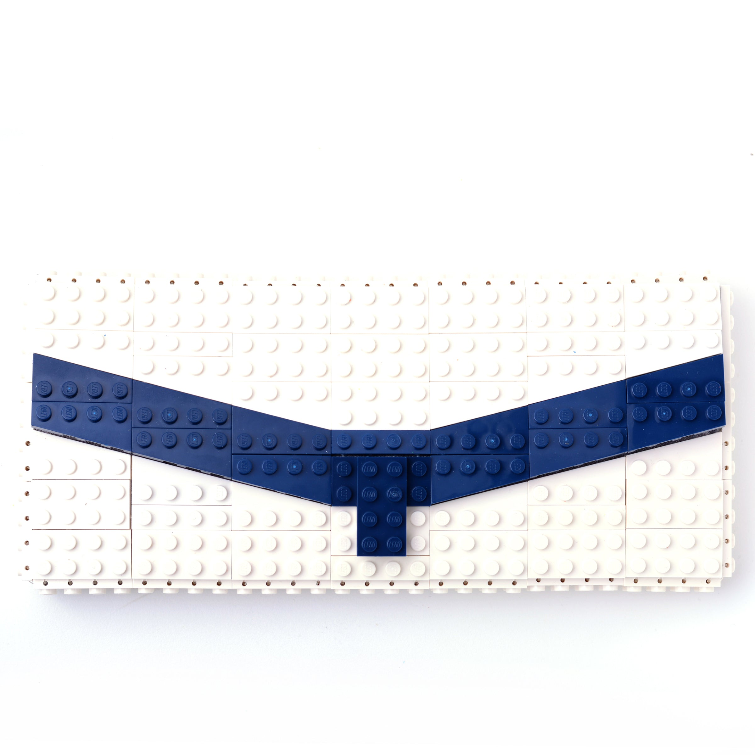 White clutch with dark blue chevron