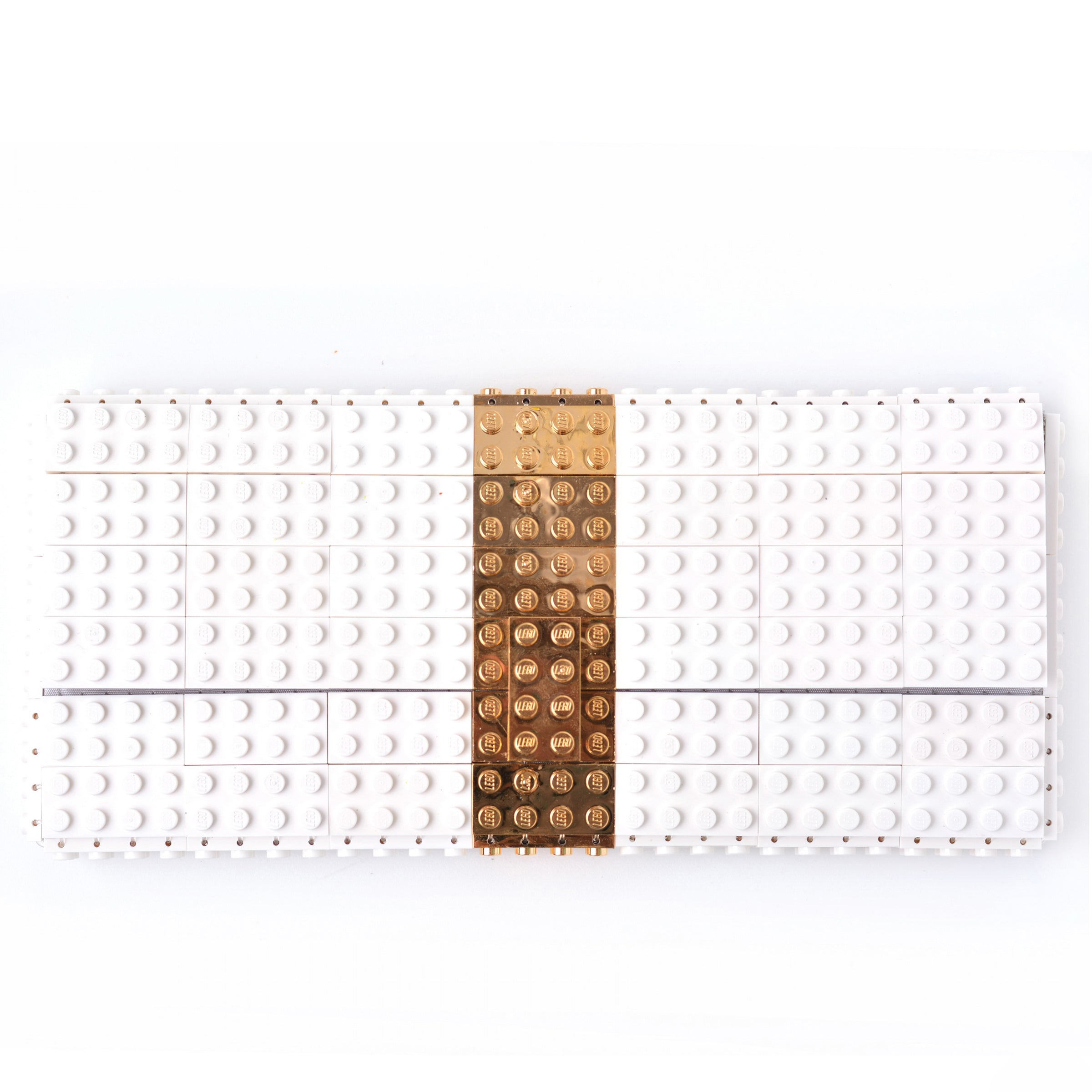White clutch with goldplated stripe
