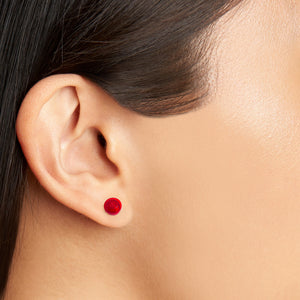 transparent red small round studs