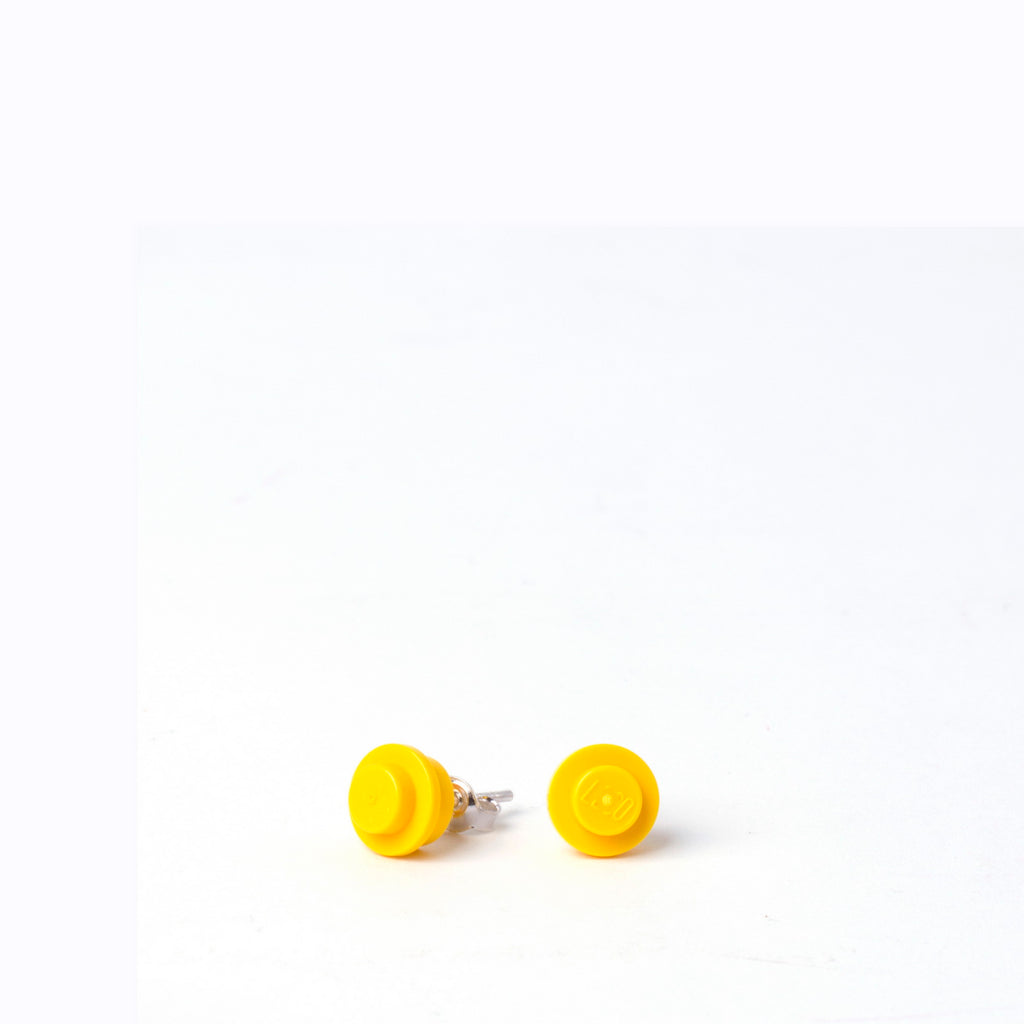 yellow small round studs