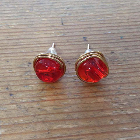 Red Studs in Brass