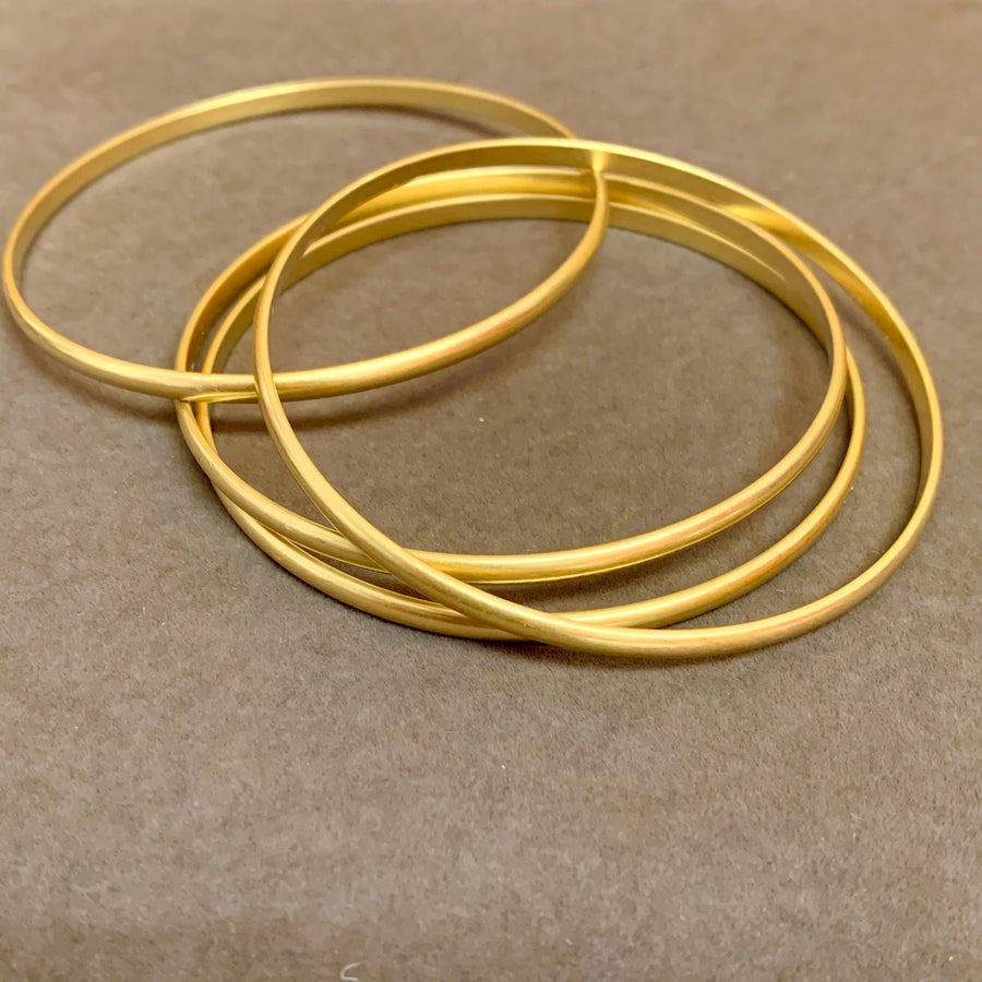 Ninotchka Brass Bangle Collection