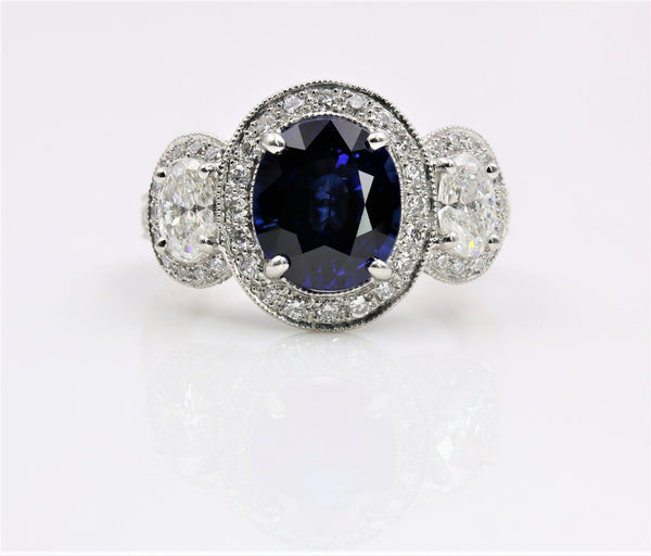 SAPPHIRE/DIAMOND HALO RING IN PLATINUM