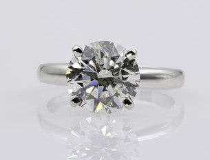 platinum steven rings ring twist claw stone round engagement brilliant diamond