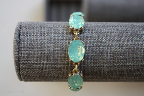 Aqua Stones, Set in Matte Gold Bracelet