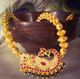 GOLDEN BEADS WITH PEACOCK THUSHI