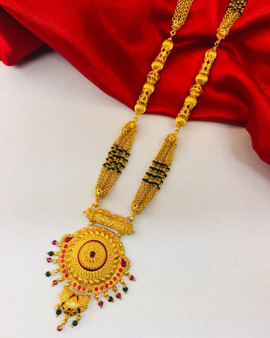TEMPLE MANGALSUTRA WITH FREE CHARLI SILK SAREE