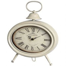 Cream oval mantel clock with small bell decoration