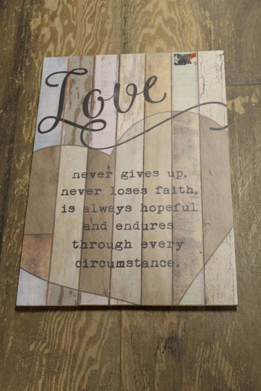 Love Never Gives Up Wooden Sign