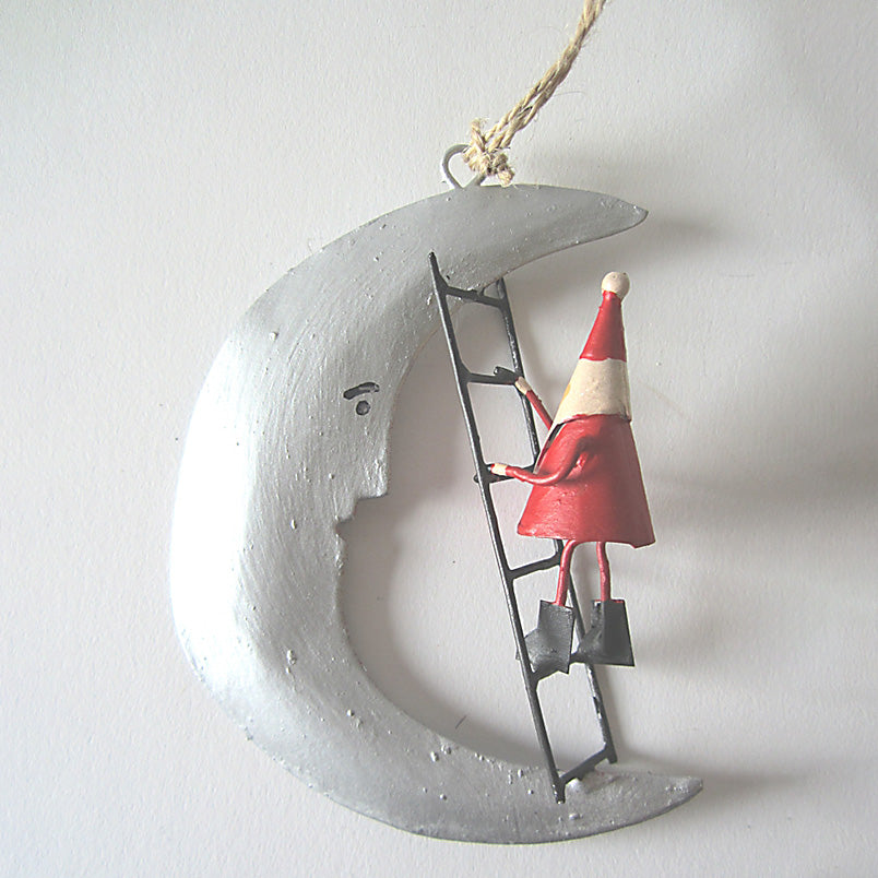 Tin Santa climbing the Moon