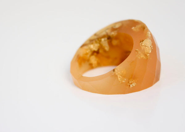 size 8 satsuma gold  round faceted eco resin ring featuring gold leaf flakes