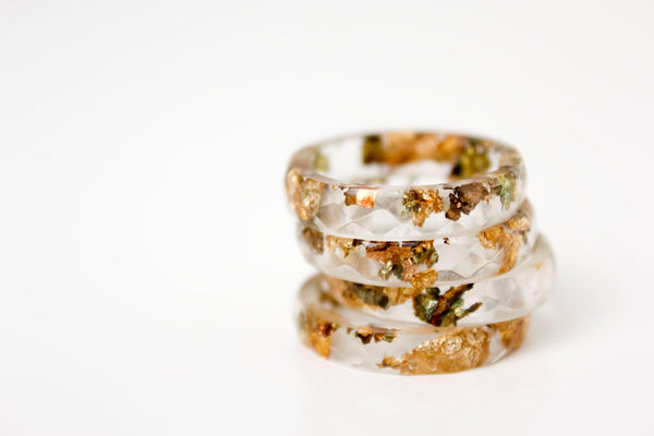 size 8 thin multifaceted eco resin ring | clear resin with variegated metallic gold leaf flakes