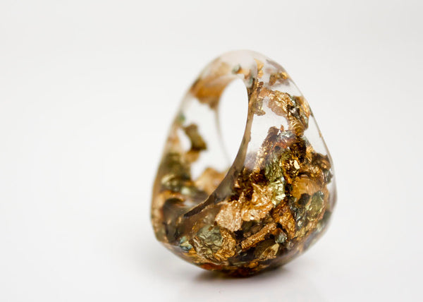 clear size 7 soft faceted eco resin ring with suspended metallic flakes