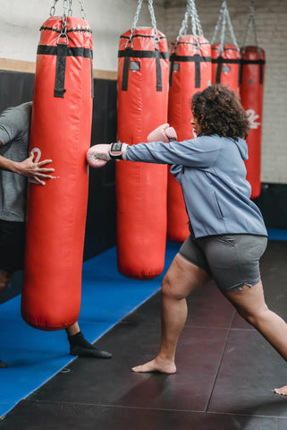 Girl Punching Bag with Instructor