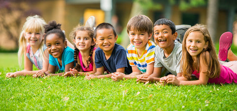 Diverse Children on Grass