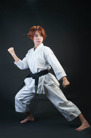 Woman Practicing Karate in Stance for Protection