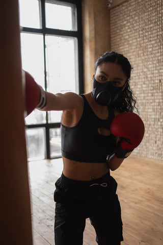 Girl Practicing Self Defense with Punching Bag