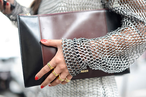 Woman Holding Bag Wearing Stackable Stones Maximalist Jewelry