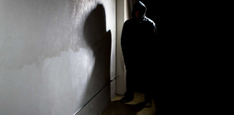 Suspicious Person in Hoodie in Shadows