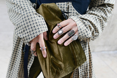 Women Holding Bag Wearing Pearl Maximalist Jewelry Rings