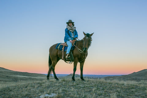 Designer, Madison McKinley Isner on her horse Comanche at the Steerhead Ranch.