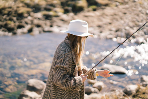 Designer, Madison McKinley Isner fishing at the Steerhead Ranch.