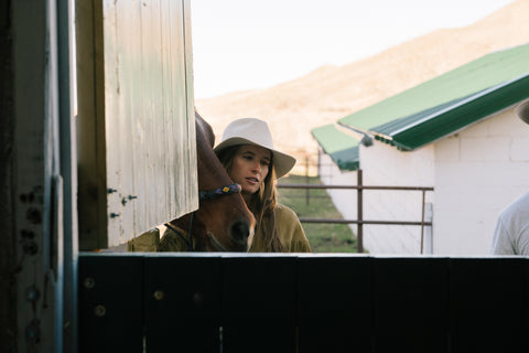 Designer, Madison McKinley Isner with her horse at the Steerhead Ranch.